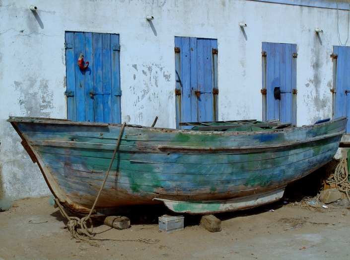 wooden boat at land
